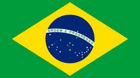 """Brazilian flag which consists of green background, large yellow square, navy blue circle in the middle with a few white stars on the bottom of the blue circle. White banner runs across blue circle that says """"Ordem e Progresso"""""""